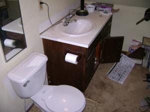 Amazing how a minor bath remodel of  a Toilet, Vanity top and some new fixtures improve a bathroom.    4 of 4