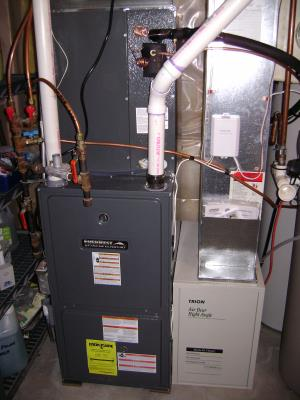 The filter rack on the lower righthand side of this furnace is an Air-Bear filter system.  It's like having 5 filters built into 1.   4 of 7