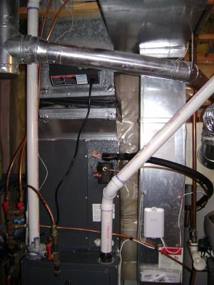 Notice the PVC intake and exhaust pipes, This means the furnace is sealed combustion, no more sending heated air outside thru combustion.   3 of 7