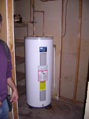 This is the replacement. An  80 Gallon Off Peak Electric water heater w/ mixing valve. A very safe and inexpensive to operate alternative.   2 of 2